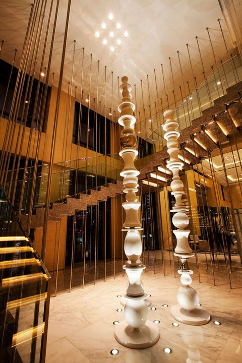 Main Lobby Grand Staircase at Swisstouches Hotel Xi'an, designed by HBA/Hirsch Bedner Associates.....