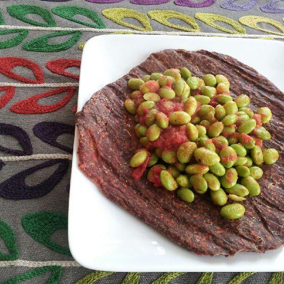 Edamame, marinara, herbamare, raw flax wrap. 24 g protein, 18 g fiber, 19 g healthy fats