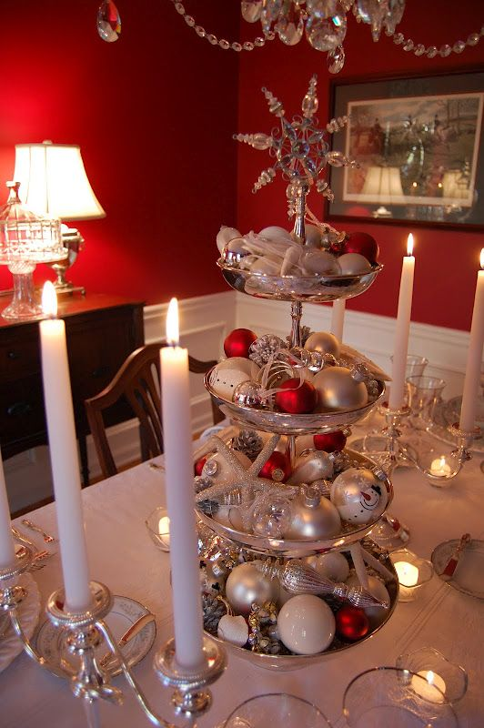 Christmas Tablescape Table Setting with Silver Tiered Dessert Stand filled with ornaments, jingle bells, shells, and starfish. Top with a pretty snowflake ornament.: