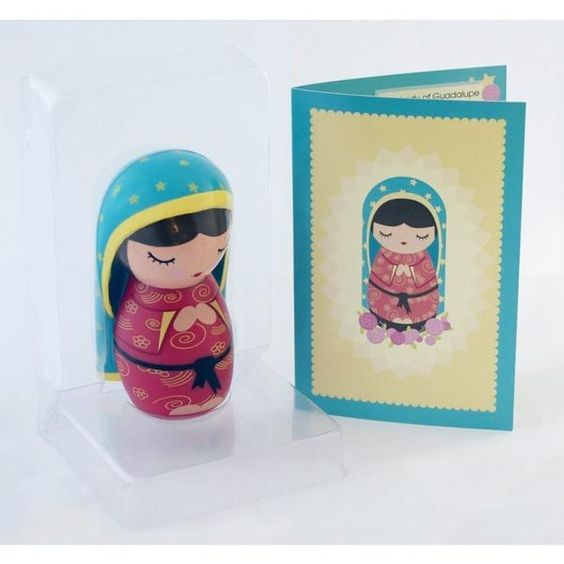 The Our Lady of Guadalupe doll is a contemporary depiction of the well known and loved image of the Virgin of Guadalupe that appeared in Mexico in 1531. The Our Lady of Guadalupe doll comes packaged in a lovely blue box perfect for gift-giving. The doll is made of high quality rotocasted vinyl; which means nothing moves, breaks, or falls off and has been safety tested and approved for children of all ages! Measuring at slightly under 3.5 inches- this little doll is a perfect fit in a child...