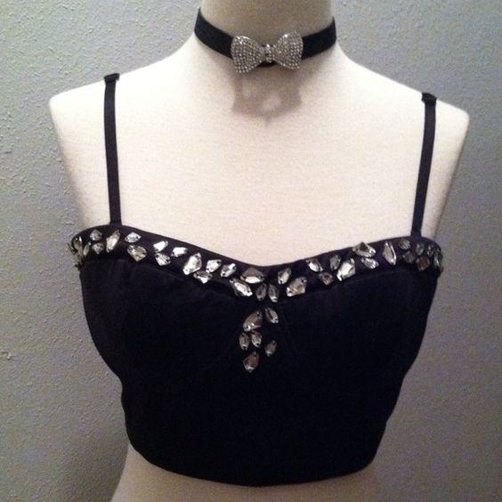 NWOT  Black jeweled bustier. NWOT Black bustier with clear jeweled design and adjustable/removable shoulder straps. Elastic banded on backside for better fit. Tops