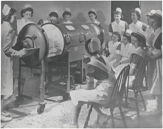 """""""Instructing nurses on the use of respirator for a polio patient"""" 1958.  Unknown photographer/location, via National Archives. These iron lungs would soon be obsolete, thanks to Dr. Salk."""