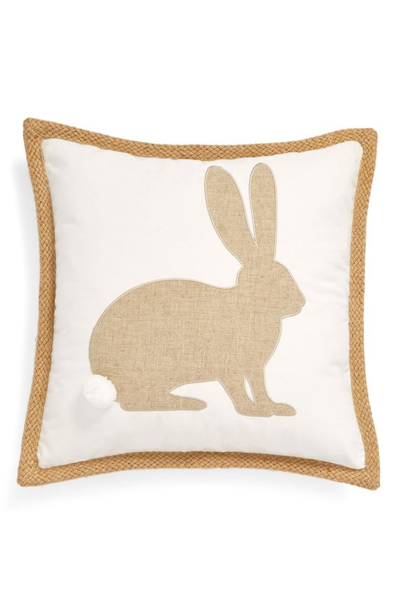A burlap bunny appliqué—complete with fluffy pompom cottontail—adds rustic charm to this cute cotton accent pillow.: