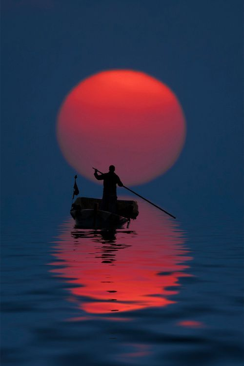 Fisherman at Sunset (China) ... Peacefully crossing the Styx at dusk? Transcendental harmony and perfection. Let it be.(Endless Seas):