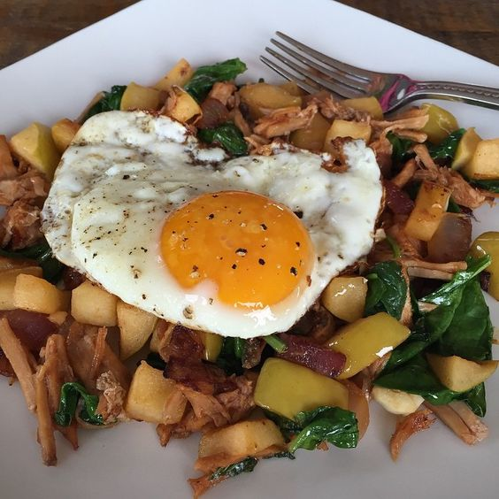 """Because Monday.  Cleaning out the fridge turned into this amazing breakfast.  Sautéed some onions, added half an apple, tossed in fresh garlic, added pulled pork, 2 cups spinach then topped with this free range, soy free organic egg.  Who says Monday has to be rough?! #paleo #healthyeating #eatbreakfast #paleohope #paleobreakfast #autoimmunedisease #hashimotos #cleaneating #glutenfree #grainfree #soyfree #dairyfree #nutfree #eattheyolks #eatrealfood #eatforhealth #fitfood #fastpaleo"