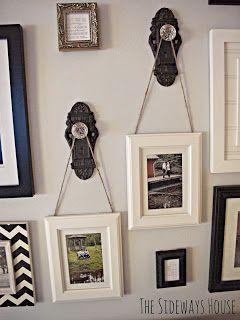 Hang pictures from door knobs... very cool idea!