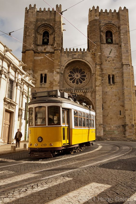 "Lisbon, Portugal - 1st lisbon church ""Sé de Lisboa"" built in 1150.  Lisbon's typical trolley/tram."
