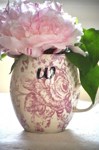 A peony adorns a mug