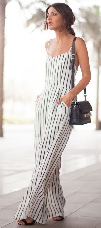 black and white striped jumpsuit with black small cross body bag: