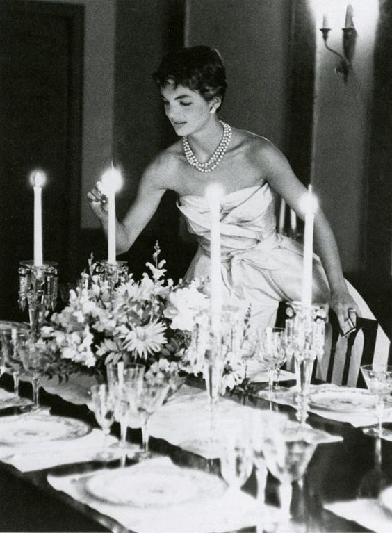 Jackie Kennedy preparing for the young couple's first dinner party at their Georgetown home on Dent Place, May 1954. Photo by Orlando Suero