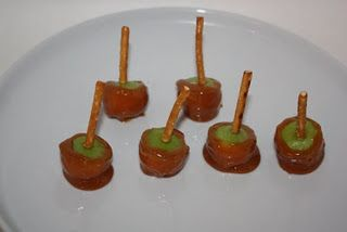 Mini caramel/chocolate dipped apples.  I have done this several times and it is awesome!  Everyone LOVES it!  I make a caramel sauce and a choc. sauce and then I let everyone dip their mini apple in whatever sauce they like and then roll in all sorts of things like nuts, mini choc. chips. coconut, sprinkles etc.  I use fancy tooth picks instead of pretzels as they get soggy.  Really a BIG hit!