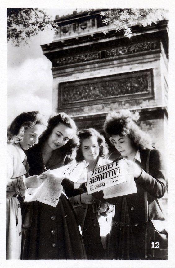 Girls reading newspapers, Paris, 1945