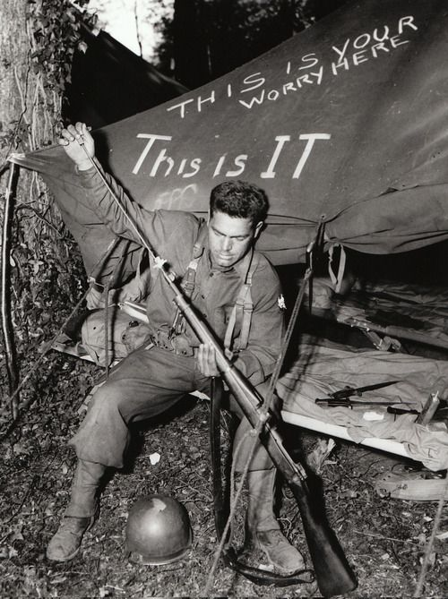 A U.S. Army soldier cleans his M1903 bolt-action rifle in a camp in England shortly before the Normandy invasion. Although the U.S. Army had adopted the semiautomatic M1 Garand rifle in 1937, a large number of M1903s were still being issued in 1944.  Martin K. A. Morgan, author of The Americans on D-Day: A Photographic History of the Normandy Invasion, due out in a few weeks, explains why M1903s were still in use on D-Day.