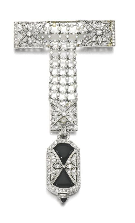 Lady's seed pearl, onyx and diamond fob watch, 1920.   The cut-cornered rectangular dial applied with Arabic numerals, signed Weinberg, the reverse decorated with onyx and single-cut diamonds, to a seed pearl mesh chain and brooch, accented with single-cut diamond panels. Via Sotheby's.