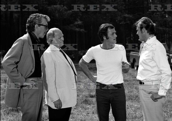 Tony Curtis, Roger Moore, Laurence Naismith and Robert Hutton