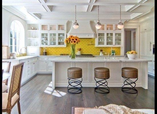 yellow tiles and bar stools