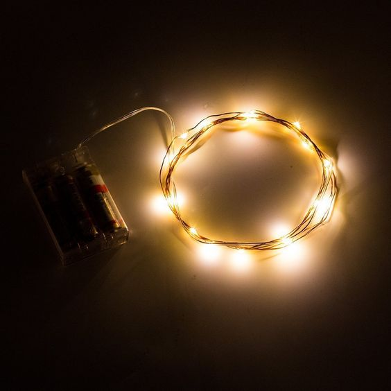 16 foot, 50 Warm White LED Fairy Lights with AA battery Pack.  $19.75  Can be used in water (see the site)