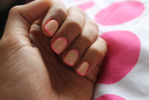 neon outlined nails.