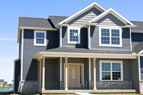 Deep Granite Shakes And Board And Batten Siding With Natural Slate Siding White Trim And Black Roof In Savoy Il Siding White Trim Exterior House Colors