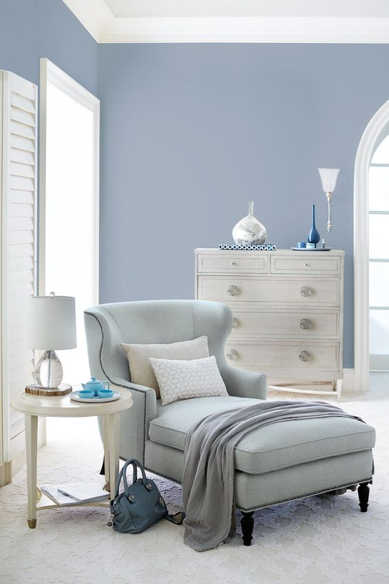 Bernhardt | Nadine Chaise in a pale blue woven | Criteria Drawer Chest with stainless steel inline, astroid pulls, stretcher base | Criteria Round End Table