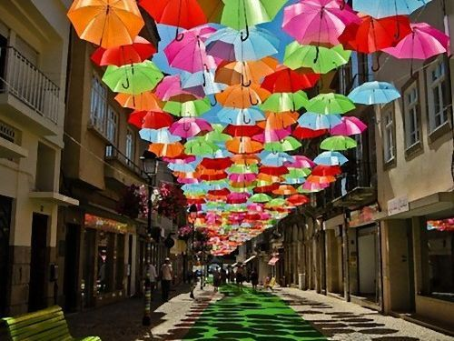 Colorful Umbrellas Magically Float in Mid Air