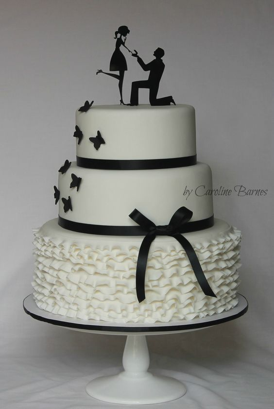 Black and white silhouette engagement cake - with ruffles, butterflies and 'On bended knee' cake topper.