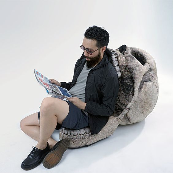 ::Join us on Facebook (http://www.facebook.com/ChicSinDesignCo) for our updates and promotions::  The SKULL Chair has a movable jaw which can