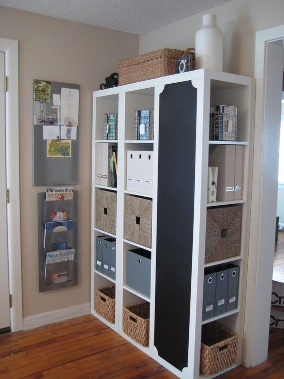 Great organization idea - 3 IKEA bookshelves with one turned to the side and painted with chalkboard paint.