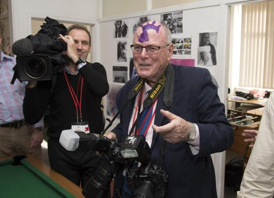 Prince Harry's purple handprint empalms Royal photographer Arthur Edwards' head. Just a little fun between friends eh! Find the VIDEO AT... http://entertainthis.usatoday.com/2015/05/15/oh-harry-prince-plays-a-purple-prank-on-the-royal-photographer-in-new-zealand/