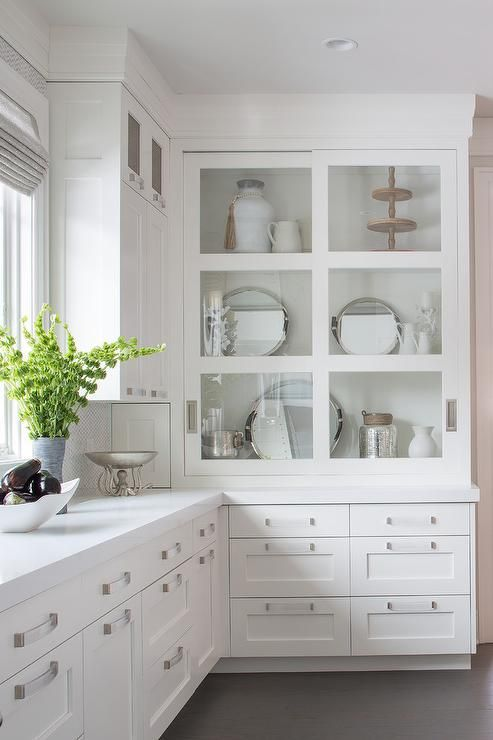 White Drawers Donning Satin Nickel Pulls And A White Quartz Countertop Are Fitted Ben Kitchen Cabinet Layout Glass Cabinet Doors Kitchen Cabinets Design Layout