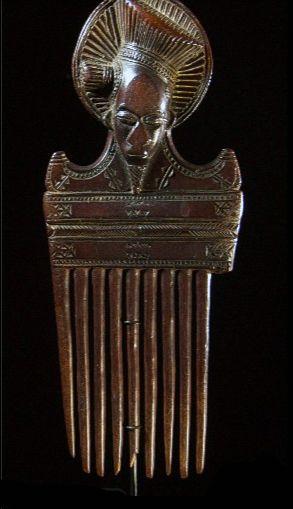 Ashanti comb of woman wearing turban