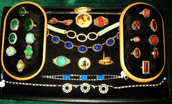Various Art Deco necaklaces, pins, and rings
