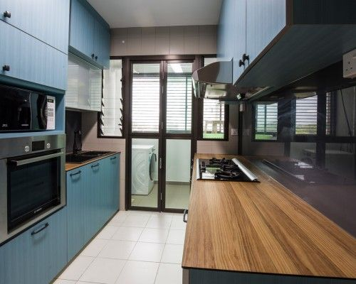 Blue Kitchen Cabinets With A Kompacplus Countertop Interior