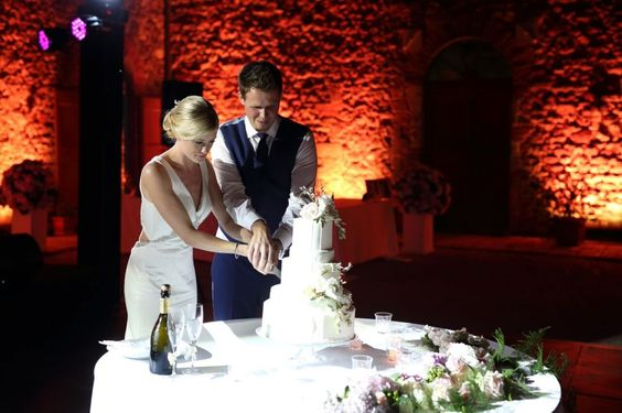 Kirsty and Tom cutting their cake http://www.styleandthebride.co.uk/a-glamorous-wedding-in-italy-with-beautiful-attention-to-detail/