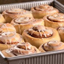 cinnamon roll recipe by King Arthur Flour. Double filling mixture and add tsp lemon or orange zest. Mix a little vanilla w/milk that is spread on the dough.
