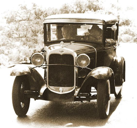 Gotta love this car from the roaring twenties in sepia.