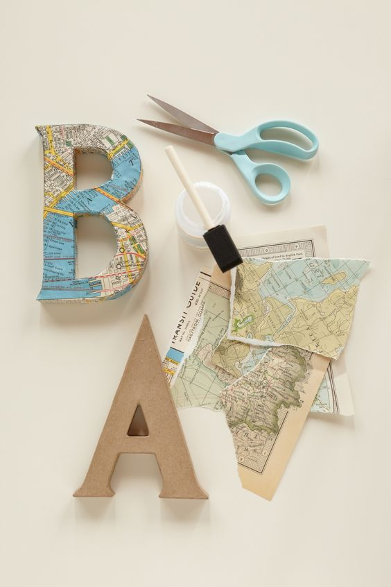 """Decoupage Letters. Use vintage maps and cut out letters to spell out """"baby"""" or the baby's name for the backdrop to your baby shower."""