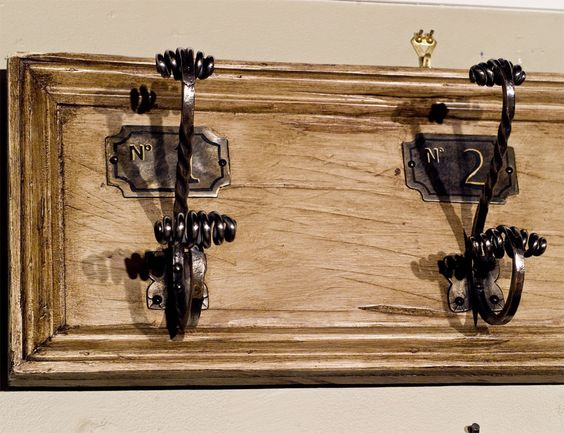 Vintage French Coat Hooks mounted  on board- polished steel | From a unique collection of antique and modern wall brackets at http://www.1stdibs.com/furniture/wall-decorations/wall-brackets/