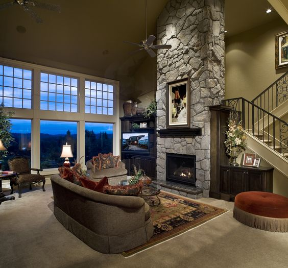 Very Large Family Room With Stone Fireplace Area Rug
