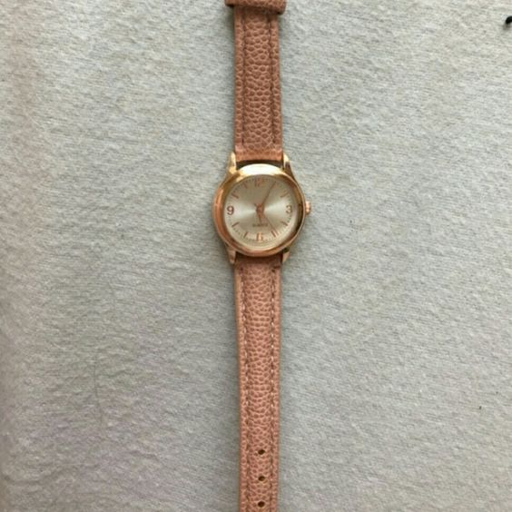 Cute! Urban outfitters gold blush watch pink Adorable and feminine watch ! Vintage looking style with smaller face. Gold hardware, blush pink faux leather band. This has never been worn. I have never seen a watch a similar to this in color and simplicity! Make an offer!:) Accessories Watches