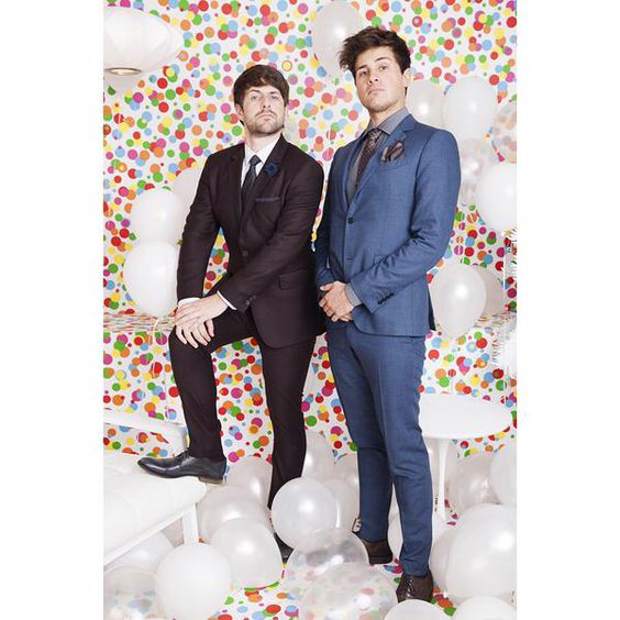 I don't know why but when I saw this pic I thought they were standing in front of millions of jellybeans or something Lol