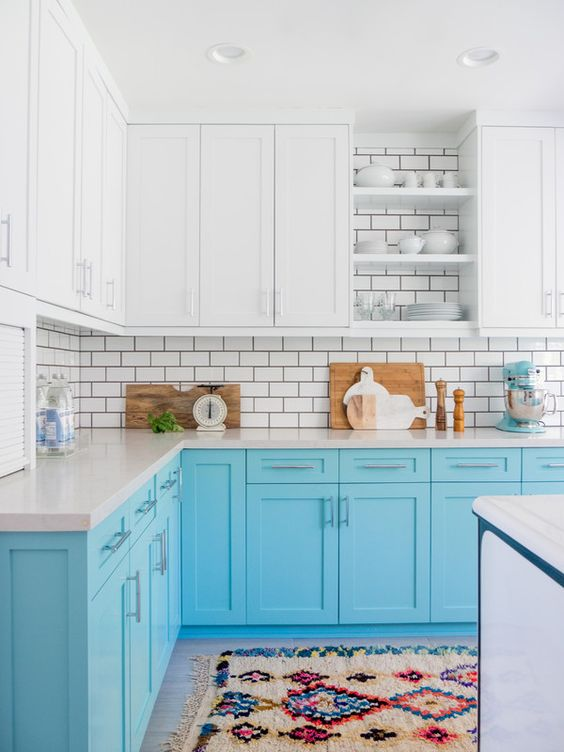 The before pictures of this 1920s kitchen are almost unrecognizable compared to the bright and sunny space it became! Adding a fresh coat of teal paint to the cabinetry instantly livened up the room with a pop of color.