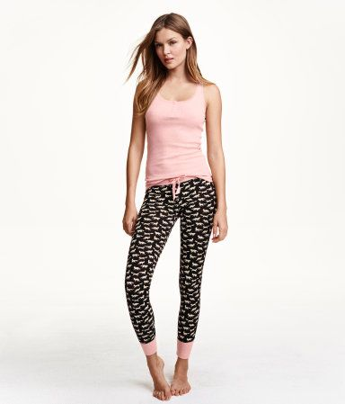 Pajamas in soft cotton-blend jersey. Tank top in ribbed jersey with short placket at top and lace trim at neckline. Pants with elasticized drawstring waistband and wide ribbing at hems.