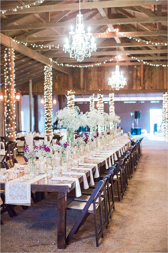 #familystyle #tabledecor #chandelier #weddinglighting #barnwedding #rusticwedding @weddingchicks