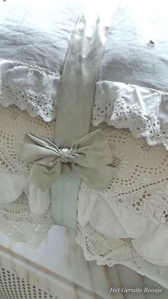 Soft shades of bed linens with sewn-on edges of purchased lace ~ all tied up with a matching silk bow!...the linen closet