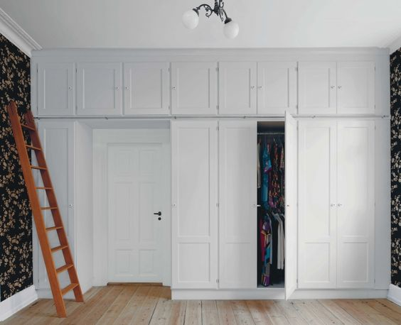 Built in closet with storage cubbies above cubbies extend - Built in closet for small bedroom ...