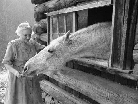 Mrs. Mary Breckenridge Runs the Frontier Nursing Service, Petting Her Horse Premium Photographic Print by Eliot Elisofon at AllPosters.com