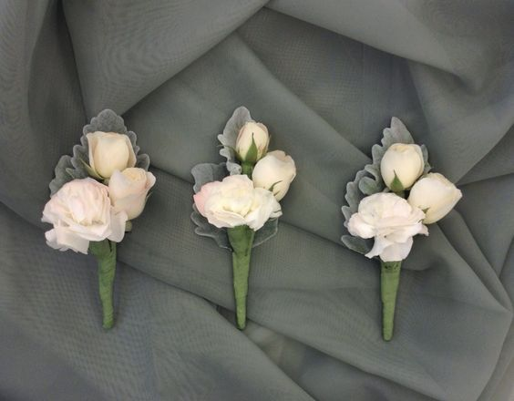 Soft pink and white boutonniere with spray roses and dusty miller