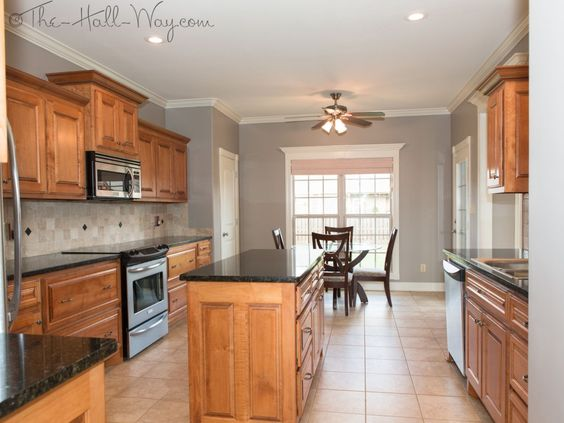Kitchen w/ Maple Cabinets with Cherry Stain and Mocha Glaze, Uba Tuba Granite, Tumbled Marble Backsplash, Wall Color - Behr Perfect Taupe