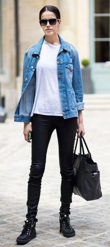 A denim jacket over a basic white t-shirt worn with black pants ...
